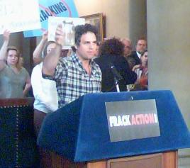 Actor Mark Ruffalo raises a jar of tainted water from a home near a Pennsylvania gas drilling well.