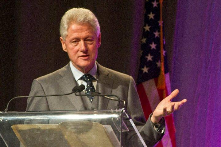 President Bill Clinton Urges Students to Make Positive Changes.