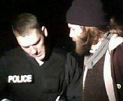 An officer gathers information from an Occupy protestor in Lafayette Park. (Albany, NY November 13, 2011)