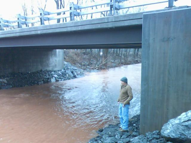 Frank Wathley looks over the waters of the Kaaterskill Creek near his home in Catskill.