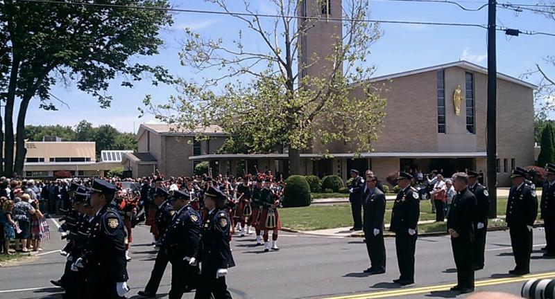 Police march from the church to the cemetery for the burial of Springfield Police Officer Kevin Ambrose