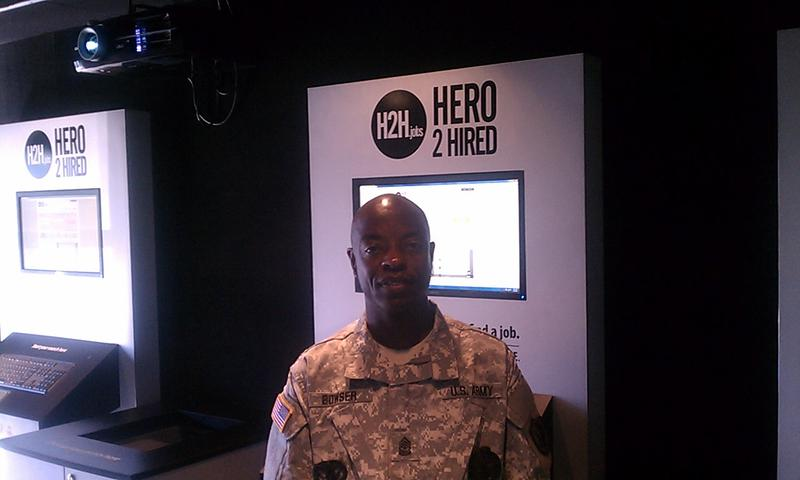 "SGM Wayne Bowser inside the ""Hero2Hired"" mobile job  store"