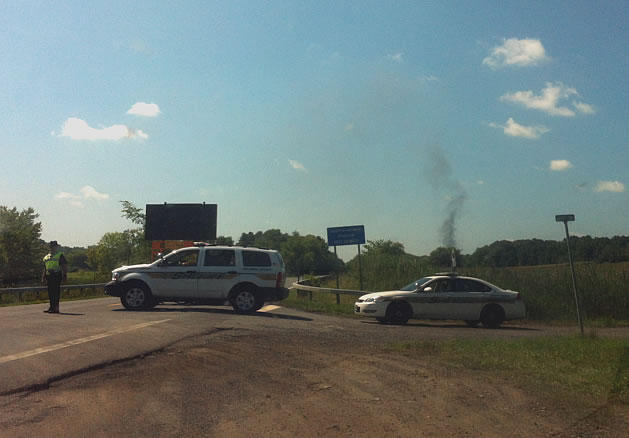 In this photo taken from NY Route 9H on 8/2/12, smoke is seen rising from the Ghent, NY area.