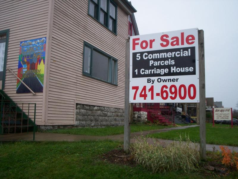 A building for sale sign
