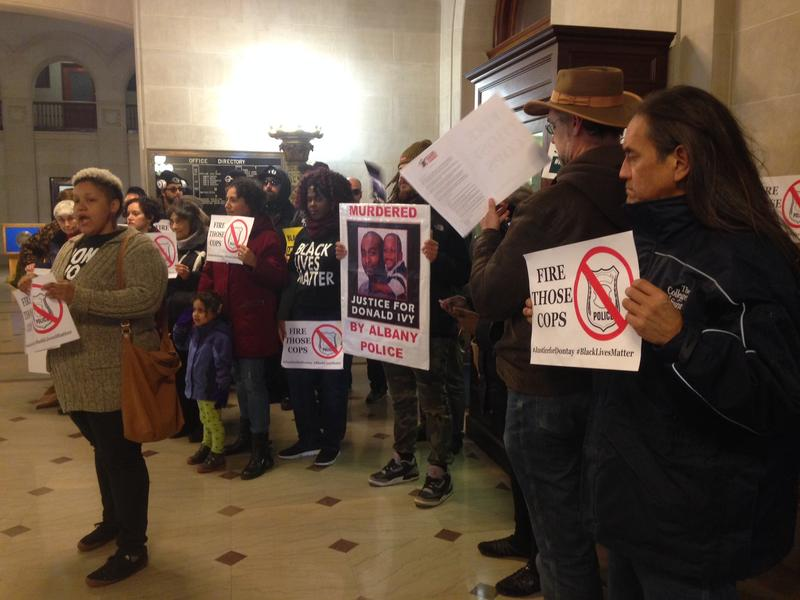 Activists gather in City Hall to deliver a list of demands.