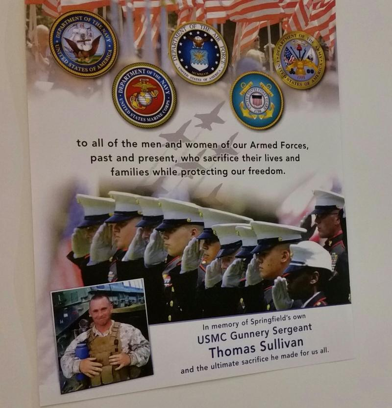 a poster announces a tribute to Marine Gunnery Srgt Thomas Sullivan