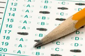 A picture of a pencil and a test