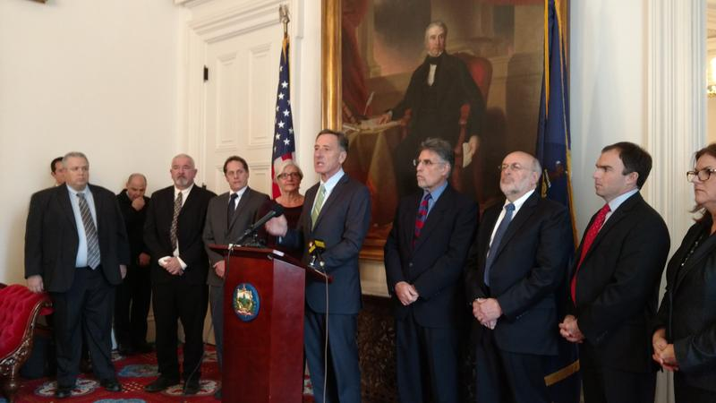 Photo of Governor Peter Shumlin with agency representatives as he announces child protection funding package