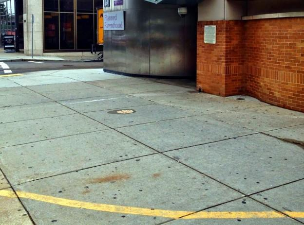 This is a picture of  A painted line denoting the 35-foot buffer zone around the entrance to a Planned Parenthood clinic in Boston, Massachusetts