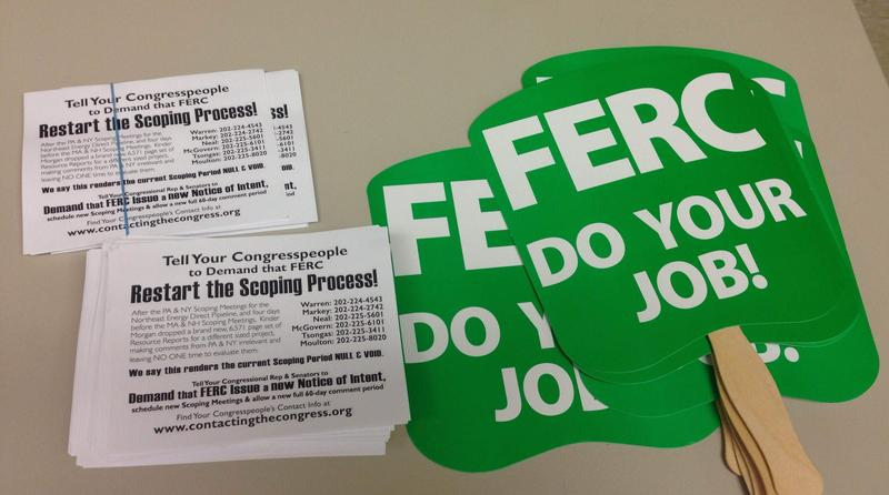 This is a picture of signs pipeline opponents carried at a FERC public hearing on the Northeast Energy Direct Project.