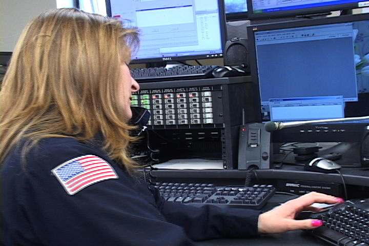 This is a picture of an emergency dispatcher at work
