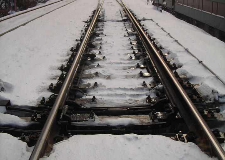This is a picture of a rail switch in snow