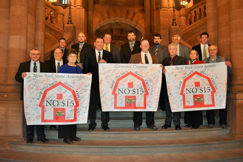 New York Farm Bureau Board of Directors with minimum wage banners at the state capitol
