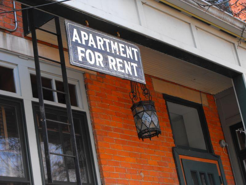 "This is a picture of an ""Apartment For Rent"" sign"