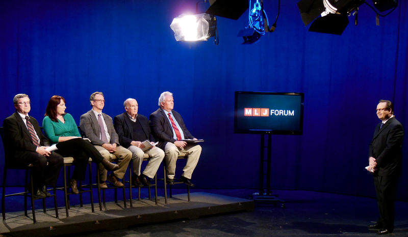 Host Thom Hallock with panel discussing NY minimum wage issues