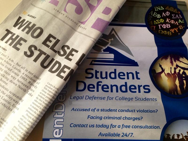 Coincidence - flier advertising legal services for students inserted in current edition of the UAlbany student newspaper.