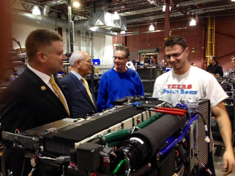 Reps. Gibson and Tonko chat with a Plug Power employee.