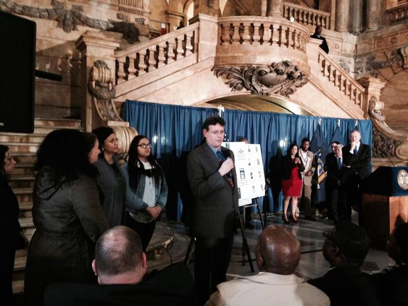 This is a picture of Norman Rockwell Museum Education Curator Tom Daly speaking at the renaming ceremony at New York City Hall Thursday.