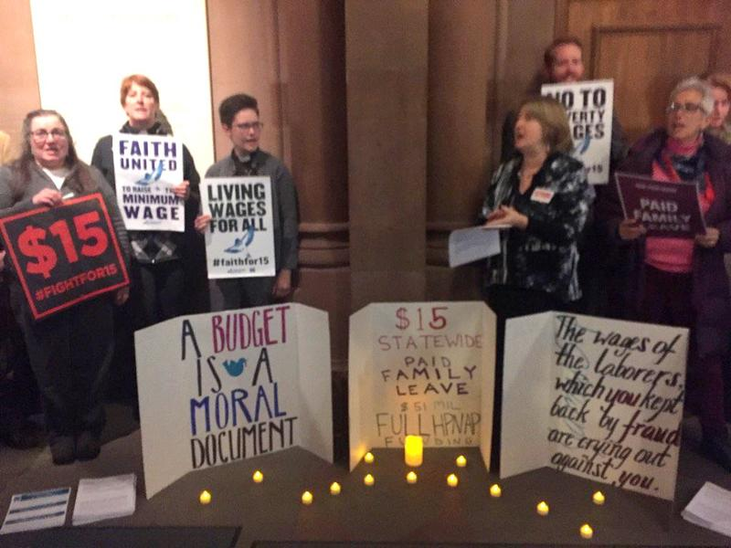Minimum wage supporters hold a vigil outside the governor's office as Cuomo and legislative leaders finalize budget details.