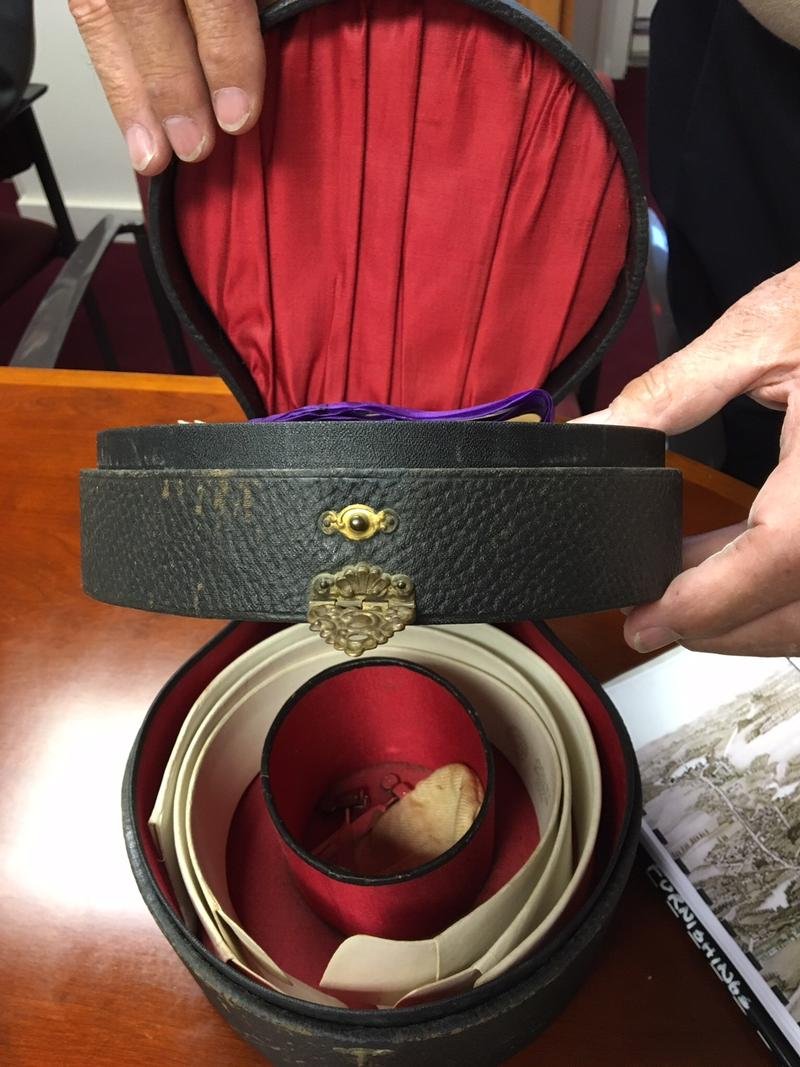 This box holds collars and other articles of 1860s male fashion.