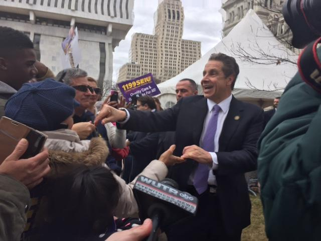 New York Governor Andrew Cuomo greets crowd of union workers after speech on raising  the minimum wage at a rally outside the State Capitol on Tuesday.