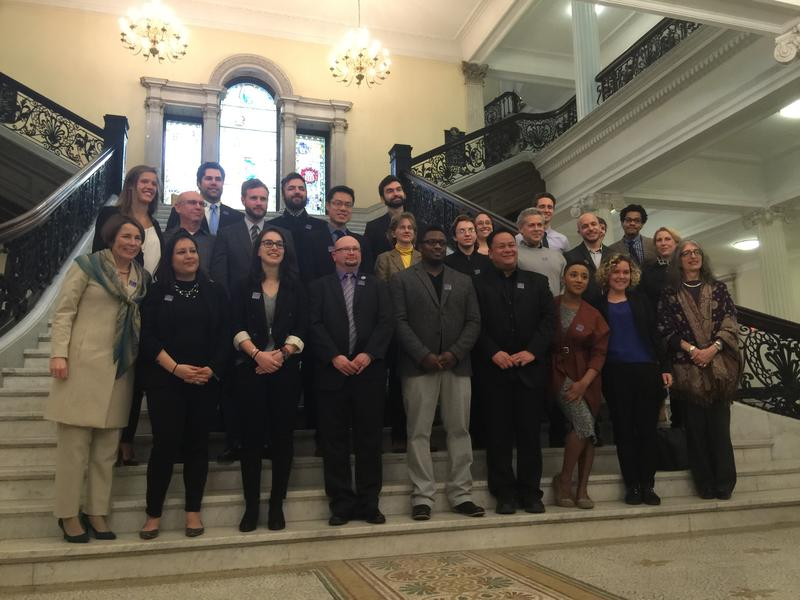 This is a picture of Massachusetts Attorney General Maura Healey taking a photo with members of the state's Commission on LGBTQ Youth at their swearing-in ceremony.