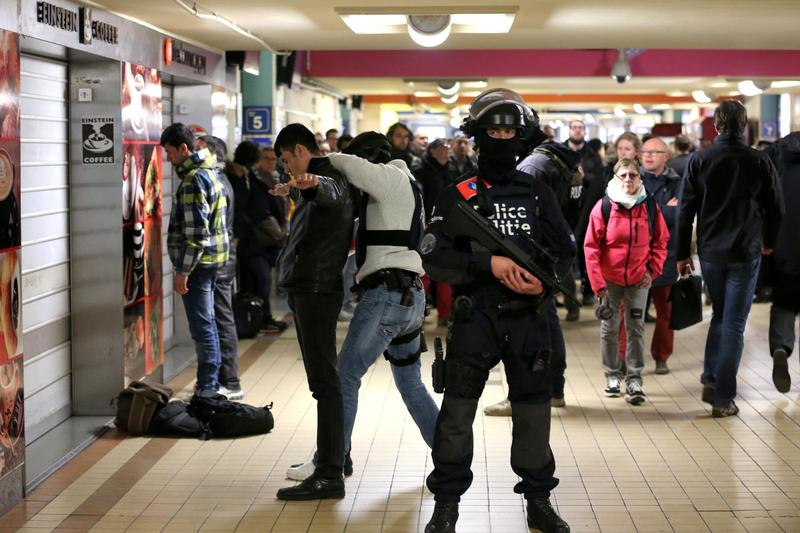 Police forces conduct searches inside the North station (Gare du Nord or Noordstation) on Tuesday in Brussels, as stations are opened again with high security measures in place.