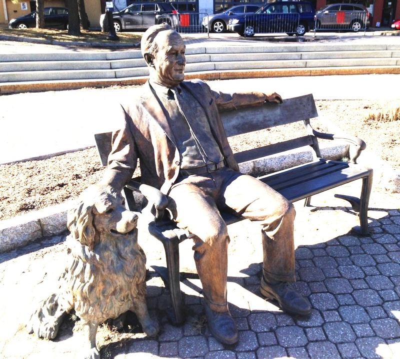 A bronze statue of Albany's 73rd mayor Thomas Whalen III and his golden retriever Finn McCool in Tricentennial Park.