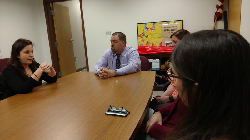 Stefanik with school officials