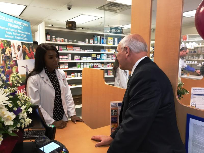 Congressman Paul Tonko chats with phramacy student Odiri Duru.