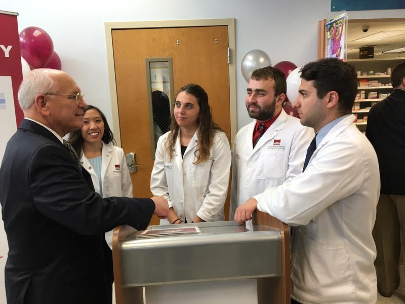 Congressman Paul Tonko chats with students  at the newly reopened pharmacy at Hometown Health Centers in Schenectady.
