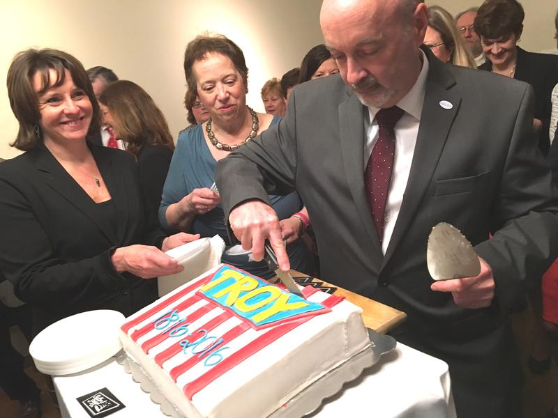 Troy Mayor Patrick Madden cuts the Bicentennial Cake.