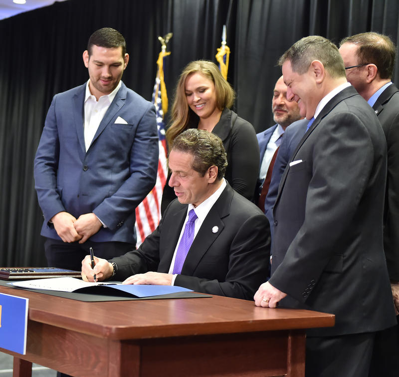 Governor Andrew Cuomo signs MMA legislation