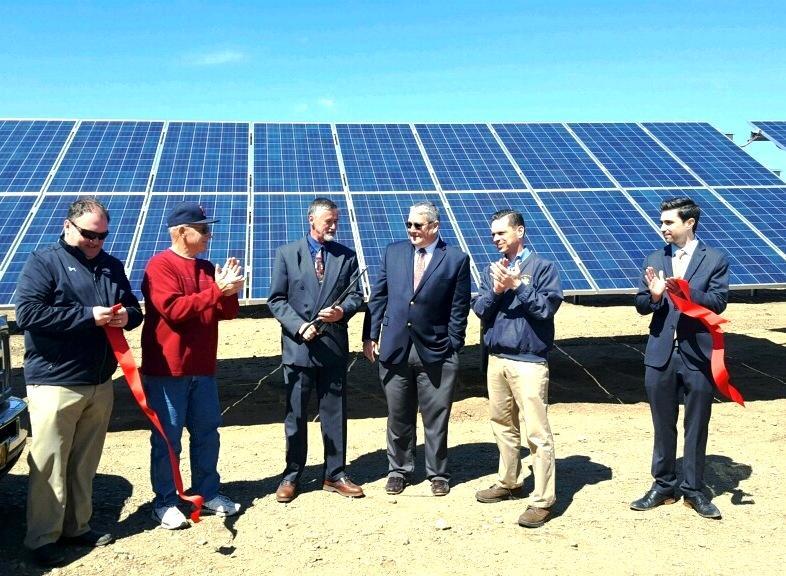 Officials including Nelliston Mayor Douglas Bathrick, Monolith's Tim Carr, Assemblyman Angelo Santabarbara and David Ziskin cut the ribbon at the solar array.