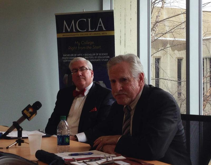 Massachusetts Higher Education Commissioner Carlos Santiago, on the right, speaks with reporters following a meeting with MCLA President Jaimie Birge.