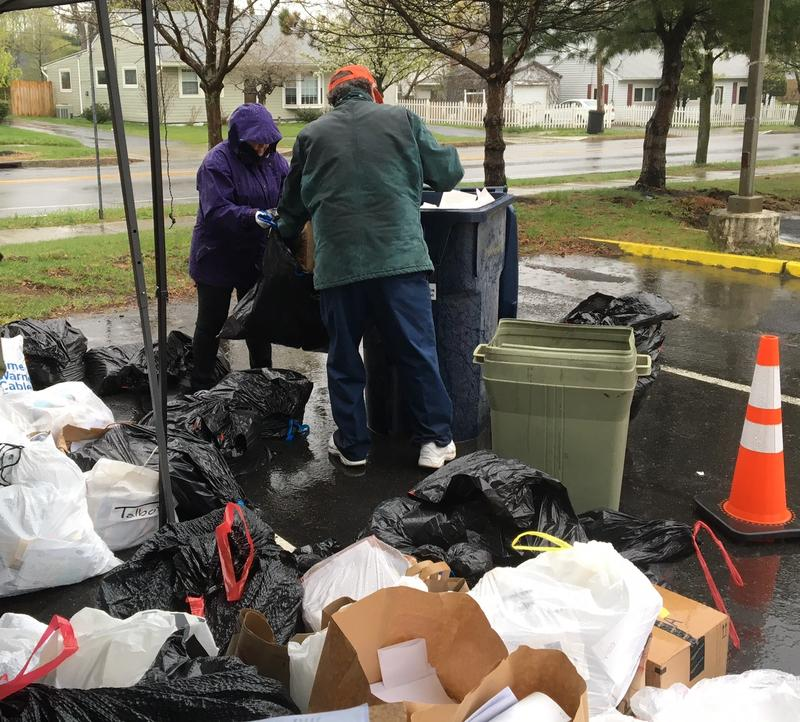 Volunteers helped load paper into the shredding truck.