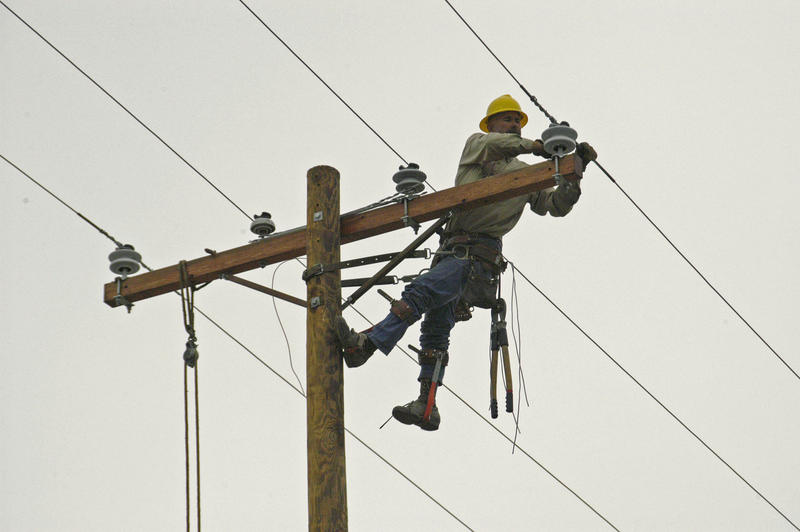 Utility worker working on power lines