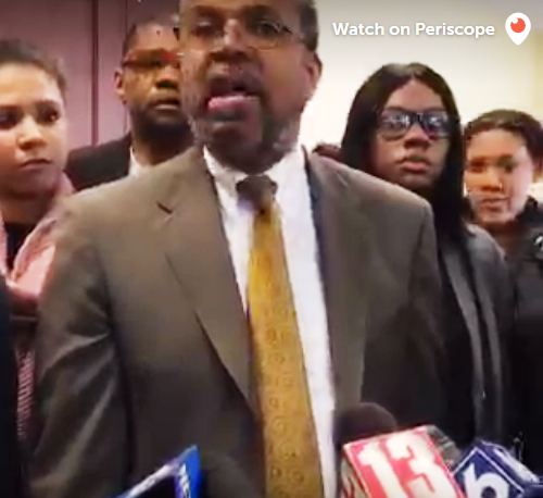 Alexis Briggs, Asha Burwell and Ariel Agudio look on as attorney Attorney Frederick Brewington speaks to reporters.