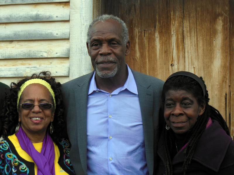 From left: Cherrie Burgess (widow of Brother Yusuf), Danny Glover and Alice Green