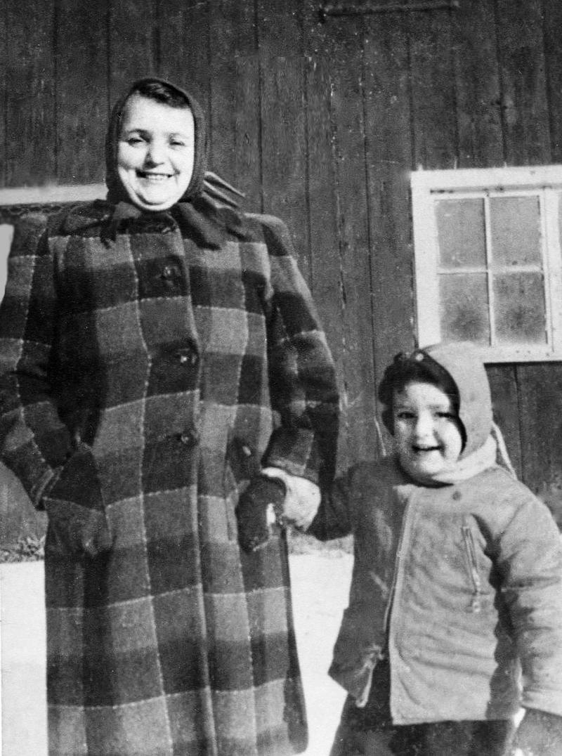 Grandmother, Anna Feder and  young Larry Fader, in front of the equipment barn on the Hoags Corner farm, ca. 1950.