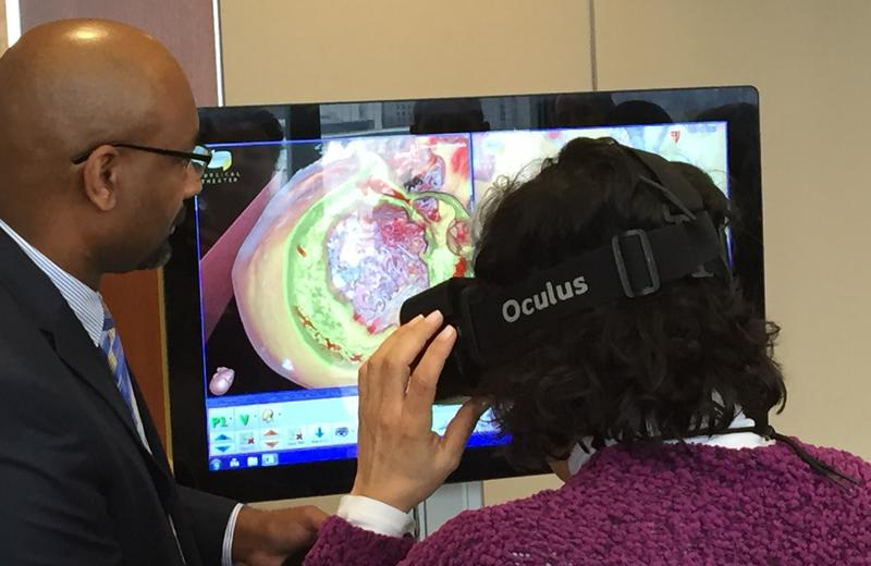 Reporter tries on the Oculus Rift 3-D virtual reality goggles at Case Western University Medical Center