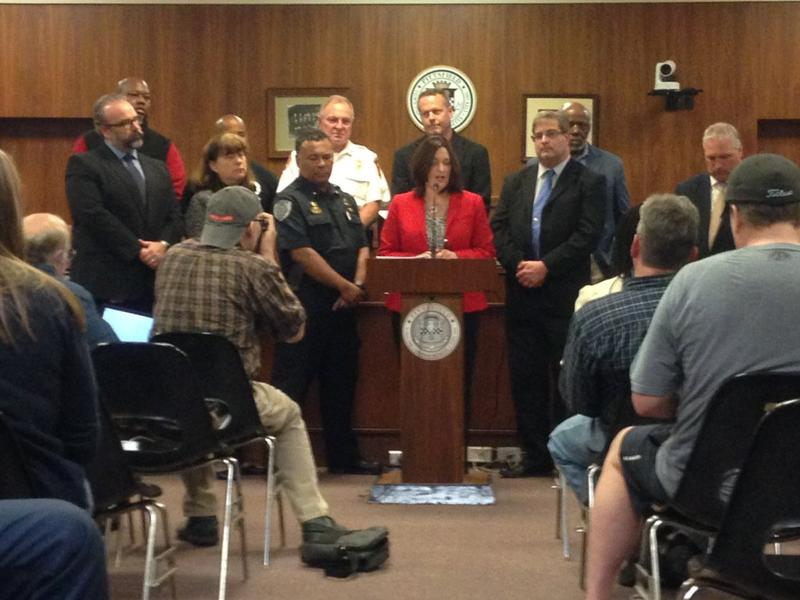 Pittsfield Mayor Linda Tyer is joined by law enforcement, school and community leaders for a press conference in Pittsfield City Hall Monday.