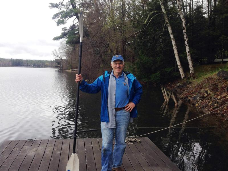 Richard Setlzer, president of the Stockbridge Bowl Association, on his dock.