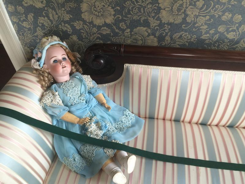 A doll in the upstairs room in Ten Broeck Mansion.