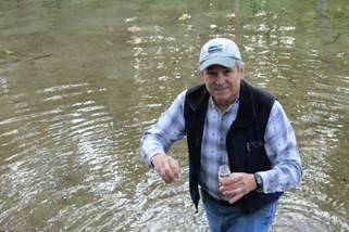 Volunteer collects river water samples for testing