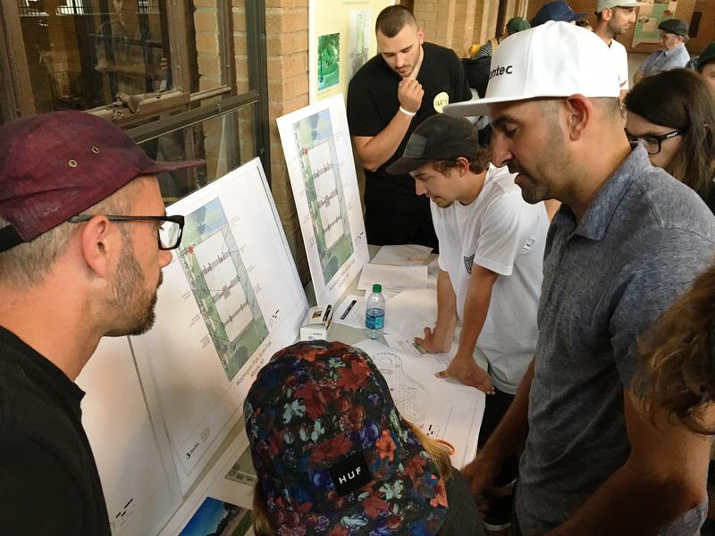 Skateboard pro Kanten Russell and local skaters brainstorm on proposed layouts for Albany's new skate park.