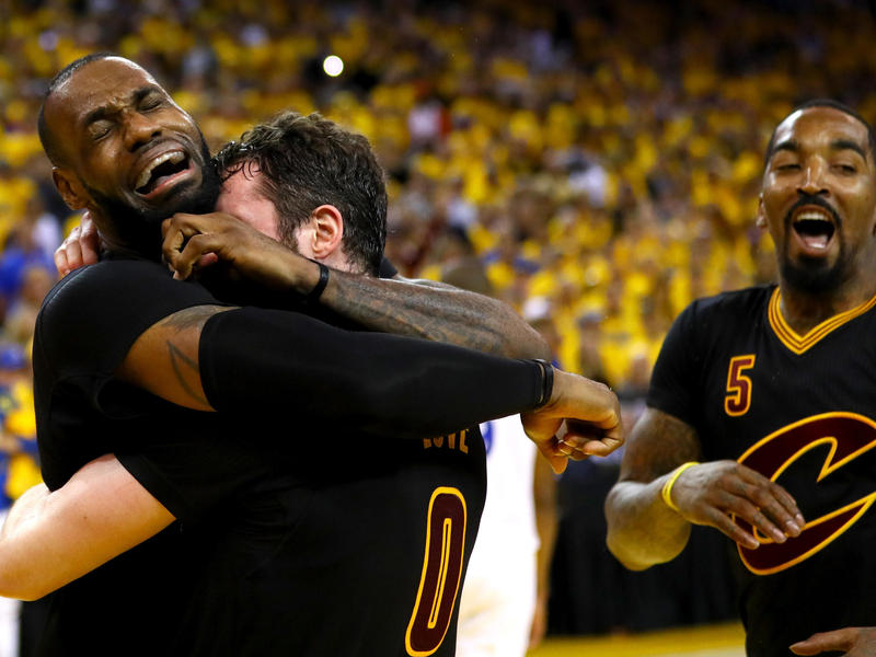 LeBron James and Kevin Love of the Cleveland Cavaliers celebrate after defeating the Golden State Warriors 93-89 in Game 7 of the 2016 NBA Finals at Oracle Arena on Sunday in Oakland, Calif.