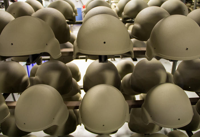 Racks of Revision's helmets fresh out of the paint booth and ready for assembly at the Newport,Vermont facility.