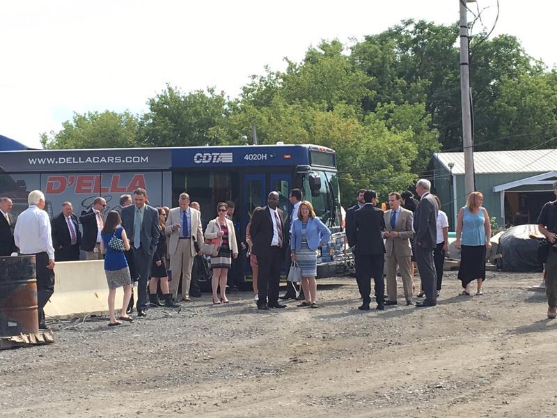 NY State Gaming Commission board members disembark from a CDTA bus that brought them to the Rivers Casino construction site.