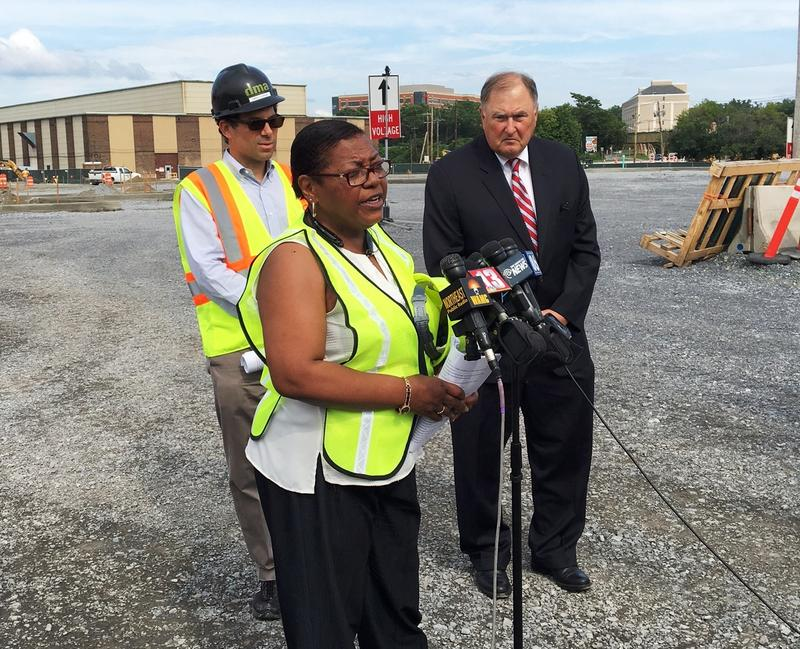 Rivers GM Mary Cheeks speaks with reporters on the casino construction site as Rush Street Gaming CEO Greg Karlin and NYSGC member John Poklemba look on.